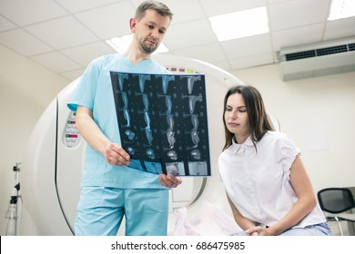 Doctor showing a snapshot of magnetic resonance imaging to a patient
