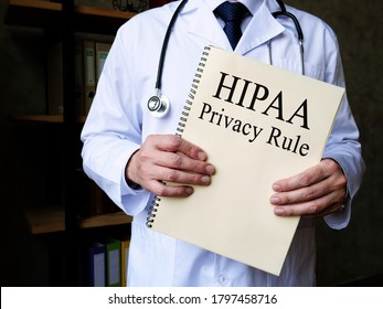 The doctor shows HIPAA privacy rule in his office.