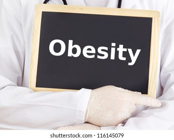 Doctor shows information on blackboard: obesity
