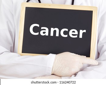Doctor shows information on blackboard: cancer