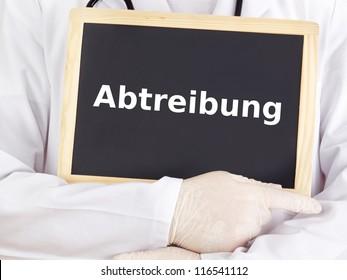 Doctor shows information on blackboard: abortion