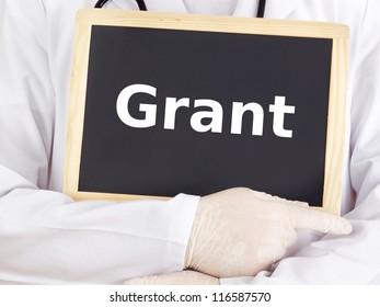 Doctor shows information on blackboard: grant