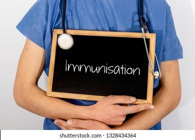 Doctor shows information on blackboard: Immunisation.  Medical concept.