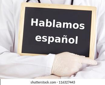 Doctor shows information: we speak spanish