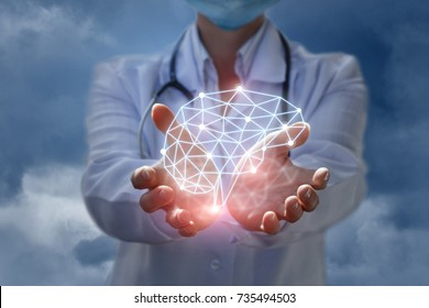 Doctor shows the model of brain thinking in hands on blue background.