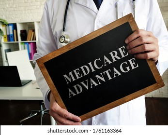 A Doctor shows a tablet Medicare advantage.