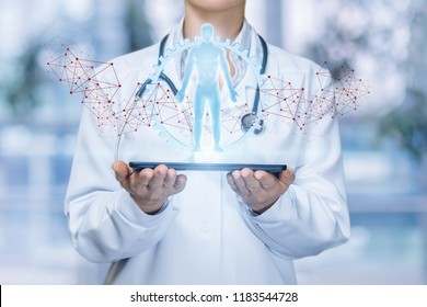 Doctor shows virtual hologram human on the tablet.