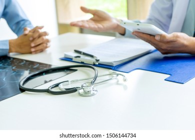 Doctor sit with patient talk consultant discuss about health care for good life.