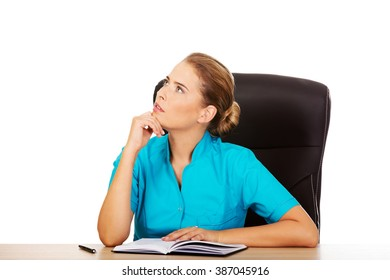 Doctor sitting behind the desk and thinking about something