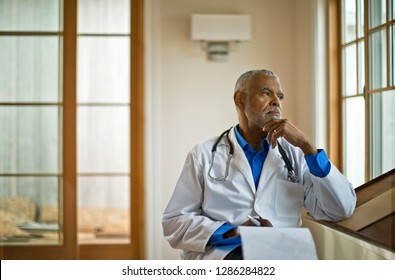 Doctor sitting and looking out the window