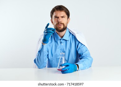 doctor sitting at a table on a light background