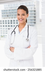 Doctor smiling looking at camera in medical office