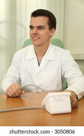 doctor with sphygmomanometer