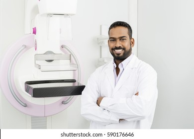 Doctor Standing Arms Crossed By Mammography Machine