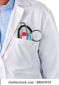 Doctor standing with stethoscope, thermometer and pens inside lab coat pocket
