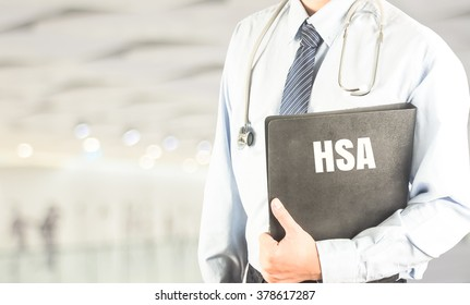 doctor with stethoscope document file word HSA (Health saving account) on modern bokeh background