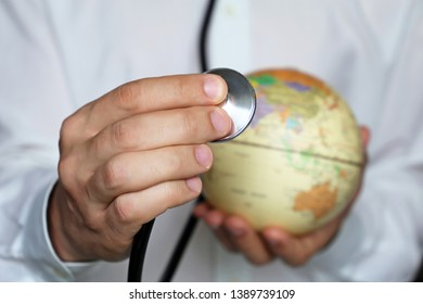 Doctor with stethoscope and globe in his hand. Medical network and health care in SouthEast Asia, India and China, concept of world medicine, coronavirus epidemic