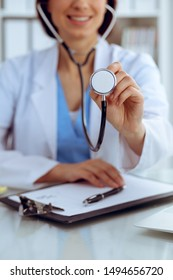 Doctor with a stethoscope in the hands, close up. Physician ready to examine and help patient. Medicine, healthcare and help concept