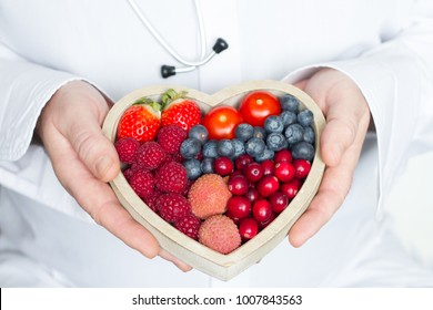 Doctor and stethoscope with heart healthy diet food abstract medicine concept