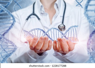 A doctor with a stethoscope is holding a dna line in her hands with the same chains on each side. The concept is the impact of modern medicine on future generations.