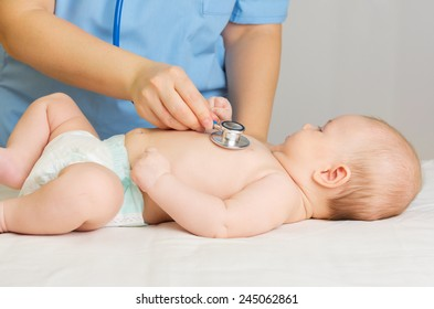 Doctor with stethoscope listen little baby