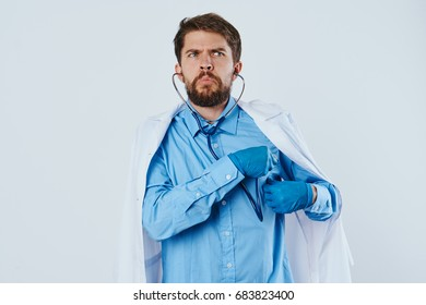Doctor with a stethoscope on a light background