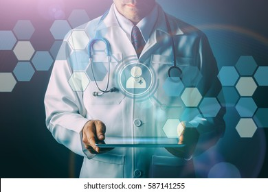 Doctor with stethoscope and tablet computer on black background, still life style, Technology digital to treat patients concept.