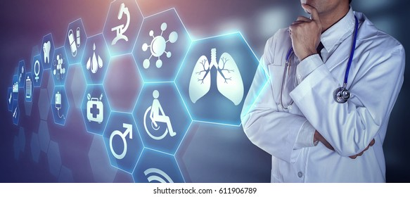 Doctor with stethoscope touching the digital icons