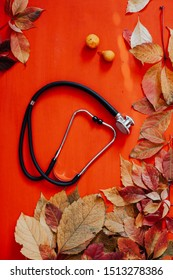 doctor stethoscope and yellow leaves autumn background