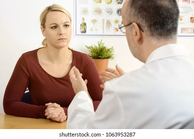 Doctor talking to a female patient shares a bad diagnosis