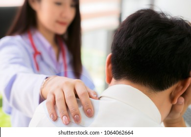 doctor talking to her depressed male patient at office