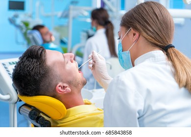 Doctor talking with her patient. Dentist concept