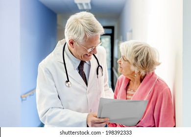 Doctor Talking to Old Woman about Good Results at the hospital.