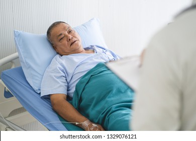Doctor talking to patient about medical treatment after surgery.