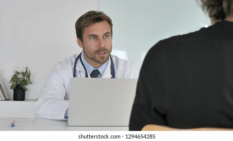 Doctor talking with Patient in Clinic