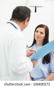 Doctor talking with a patient in an examination room