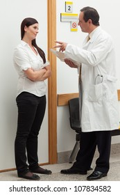 Doctor talking to a patient in a hallway