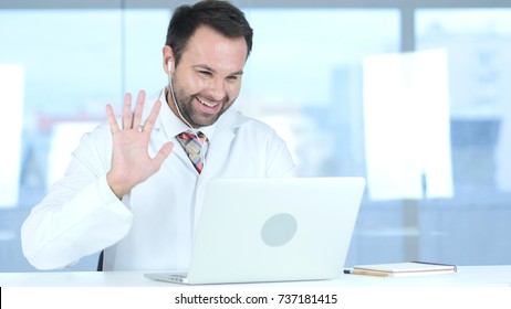 Doctor Talking with Patient, Online Video Chat on Laptop