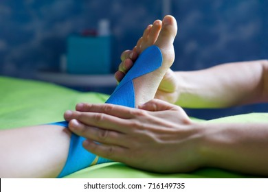 Doctor taping woman injury leg. Exercise for physio recovery