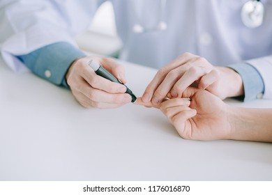 Doctor or technicain checking  the blood-sugar level  in the hospital room.