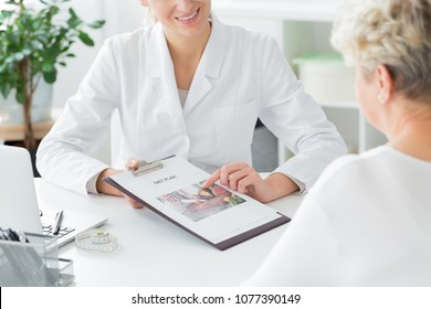 A doctor telling her patient about a diet plan. Healthy living concept
