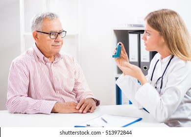 Doctor is telling to her patient how to use inhaler.