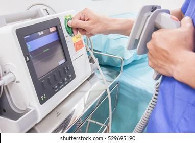 doctor test EKG or ECG monitor in emergency room
