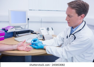 Doctor testing his patients blood at the hospital