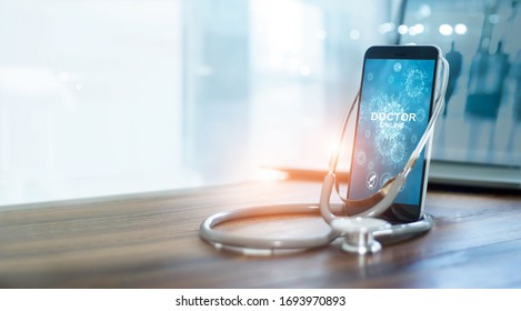 Doctor through the smartphone screen, Doctor online, Online medical communication with patient and analysis health on virtual interface, Online and medical consultation, Virtual hospital, Covid-19