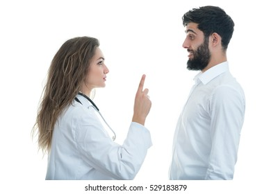Doctor with ticking clock and Serious Male Patient