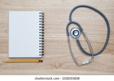 Doctor tool stethoscope on table background