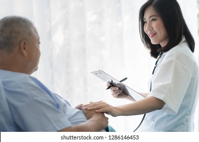 Doctor touching hands to encouragement mental of elderly patient after surgery at bed in hospital.