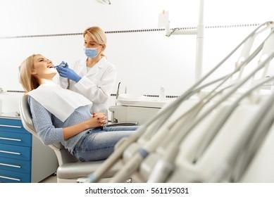 Doctor treating teeth of woman