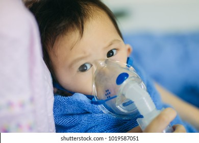 Doctor treatment a child who sick by chest infection after a cold or the flu that has trouble breathing and prolonged cough.A symptom of asthma or pneumonia cause by respiratory syntactical virus.